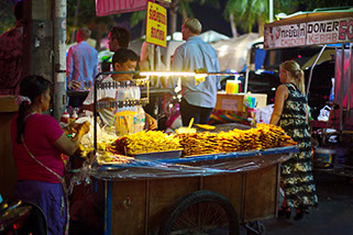 Typical food cart in Pattaya Beach, very tasty and very cheap, chicken strips on a stick.