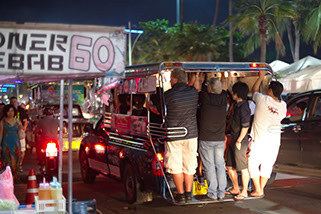 A typical Baht Bus in Pattaya on a busy night. They get pretty full with people.
